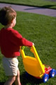 toddler pushing play mower